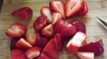 cut up the fruit into chunks, making sure to remove any inedible parts. the small pieces will make it easy to fill the jar with the fruit.