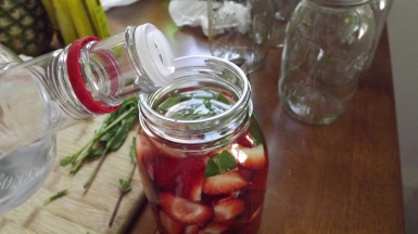 pour the vodka over the fruit, filling the jar